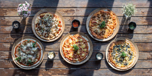 Five different flavours of pizza on a table